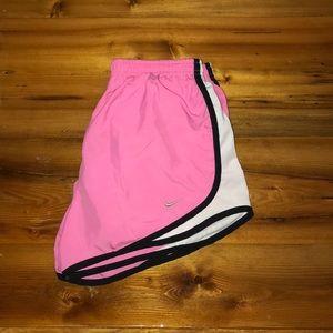 Pink Nike shorts.